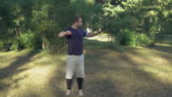 Adult jogger stretching wearing in sport shorts and t-shirt video