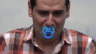 Adult Man Crying With Pacifier video