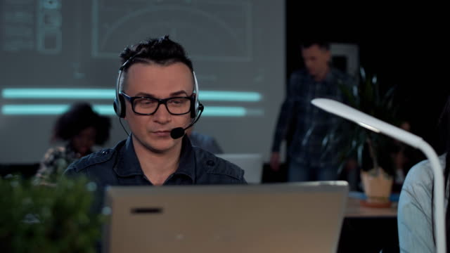 Adult man in call center video