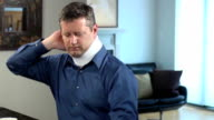 Adult Man Wearing Neck Brace Expresses Discomfort video