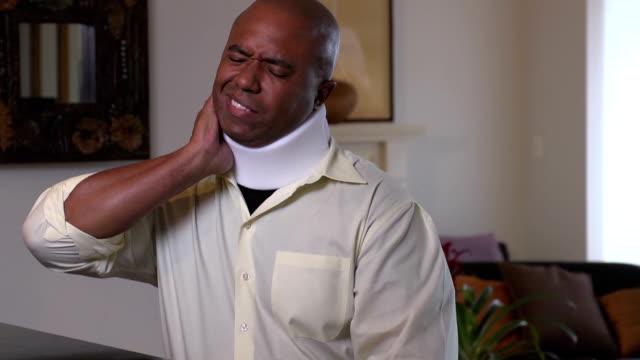 Adult Man Wearing Neck Brace Expresses Discomfort video