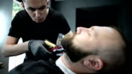 adult man with beard in a barber shop video
