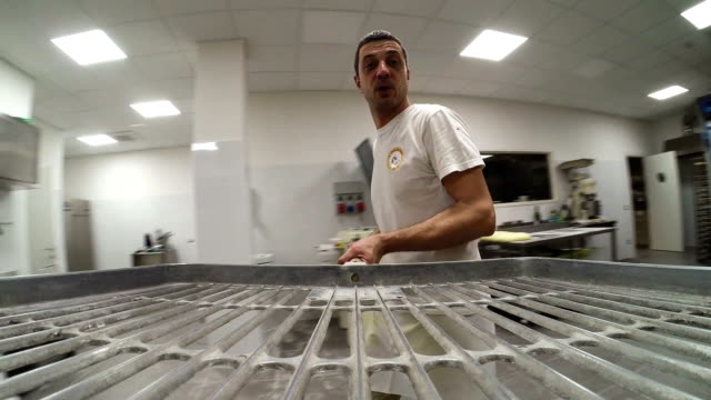 Adult man with shovel baker video