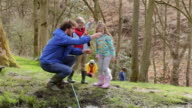 Adults And Children Exploring Pond At Activity Centre video