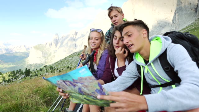 Adventures on the Dolomites: friends plan tour with maps video