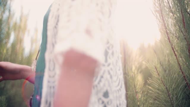 Adventurous summer boho girl in vintage dress in nature video