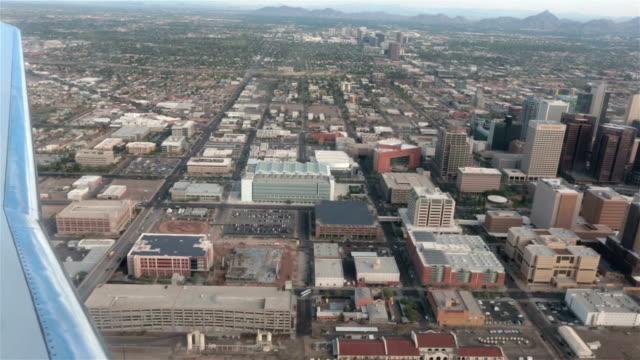 Aerial airline approach Phoenix Arizona down town urban area HD video