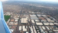 Aerial airline approach Phoenix Arizona industrial area HD video