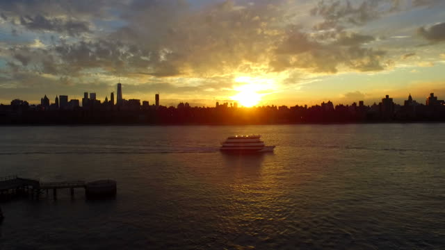 Aerial Ascent Cruise Ship And Sunset Over NYC Skyline video