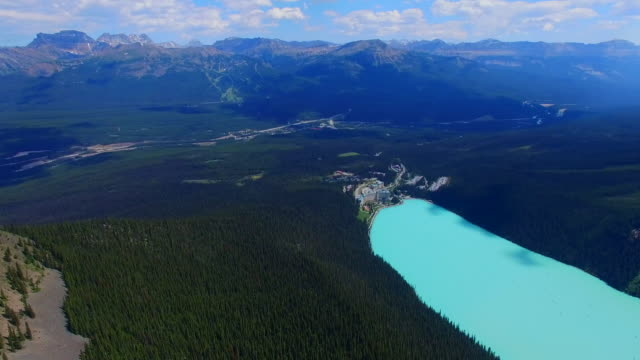 Aerial beautiful light blue lake mountains video