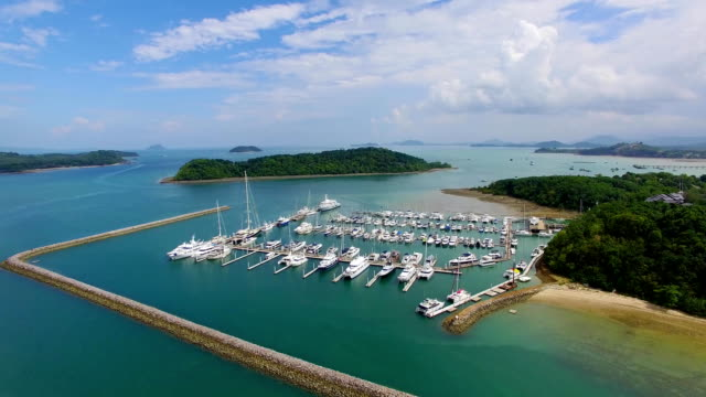 Aerial: Beautiful marina with moored yahts and ships. video