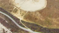 Aerial Construction of artificial reservoirs in the mountains video
