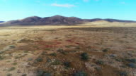 Aerial Drone Footage Of Desert And Mountains Against Sky video