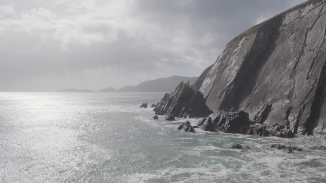 Aerial Drone Footage Of Sea And Rocky Mountains Against Cloudscape video