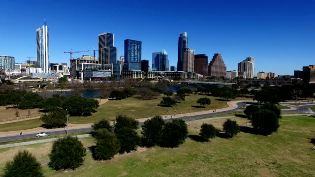 Aerial Drone Pan Across Austin Texas Butler Park a Wonderful Sunny Day Downtown Skyline Cityscape up to Capital Hill video