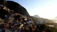 Aerial drone panning shot of hillside favela houses at sunrise video