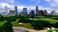 Aerial Drone Shot Austin Texas Capital Cities Skyline with Texas flag waving in the sunshine video