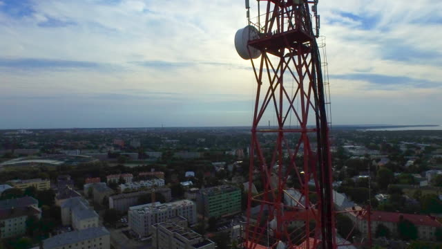 Aerial drone shot of a telecommunication radio tower mast in residential area. video