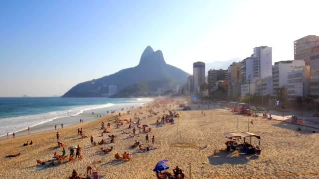 Aerial drone sweep along Leblon beach, Rio de Janeiro, Brazil at sunset video