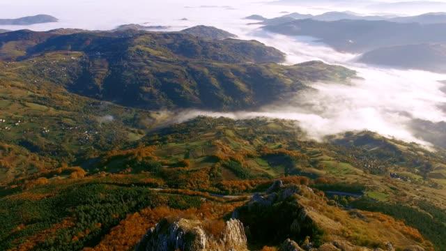 Aerial fligh over a mountain ridge peak video