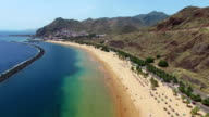 Aerial flight above beautiful famous white beach and ocean lagoon Playa de las Teresitas, Tenerife, Canary islands, Spain video