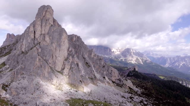 Aerial flight above mountain top in sunny day. Summer adventure journey in mountain nature outdoors. Travel exploring Alps, Dolomites, Italy. 4k drone side video video