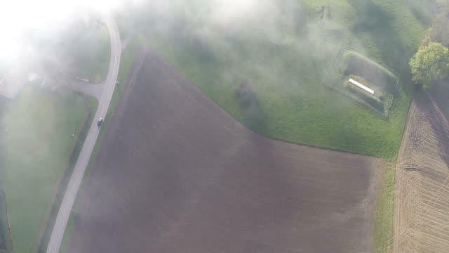 Aerial flight over a sea of fog near Sursee in Switzerland video