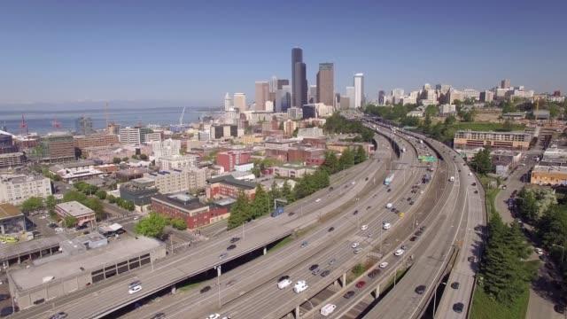 Aerial Flight Over Interstate Freeway Toward Downtown Seattle Skyscraper Buildings video