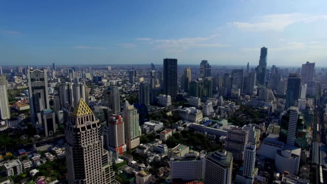 Aerial: Flight over skyscrapers in the center of Bangkok. video