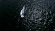 Aerial: Flight over the sailing boat on clear blue water video