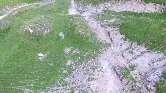 Aerial flight overBucegi mountains trails, tilt video