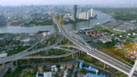 aerial fly over forward, top view of traffic and vehicle car on tollway and expressway in bangkok city area near chao phraya river, transportation concept, HD video