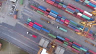 Aerial: Flying above a lot of cargo containers video