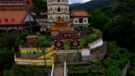 Aerial: Flying near Kek Lok Si temple. video