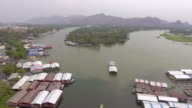Aerial flying over floating houses on mount of river with drone video