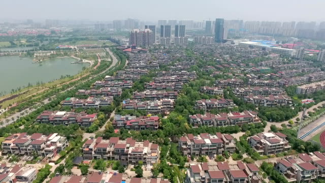 aerial flying shot of many luxurious homes in an upscale area video