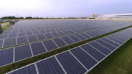 Aerial footage flying over surface of solar panels in 4K video