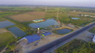 Aerial footage : Flying up the high voltage electricity tower at sunset video
