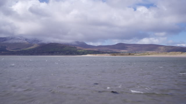 Aerial Footage Of Beautiful Mountains And Sea Against Cloudy Sky video