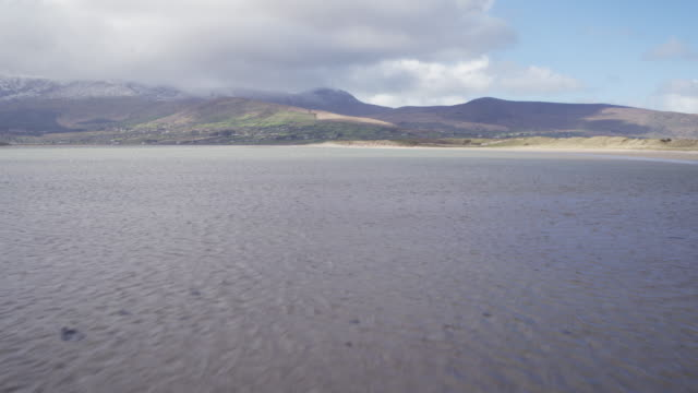 Aerial Footage Of Beautiful Sea And Mountains Against Cloudy Sky video