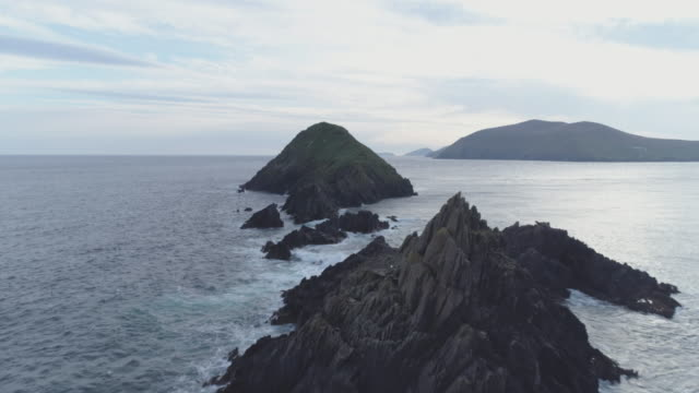 Aerial Footage Of Rock Formations Amidst Ocean During Sunset video