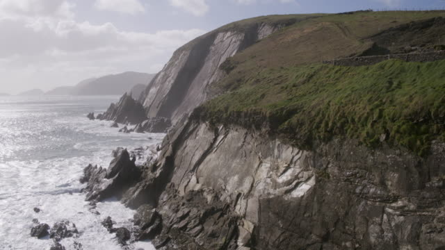 Aerial Footage Of Sea And Mountain Cliff Against Cloudy Sky video