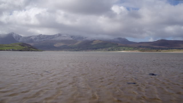 Aerial Footage Of Sea And Mountains Against Cloudy Sky video