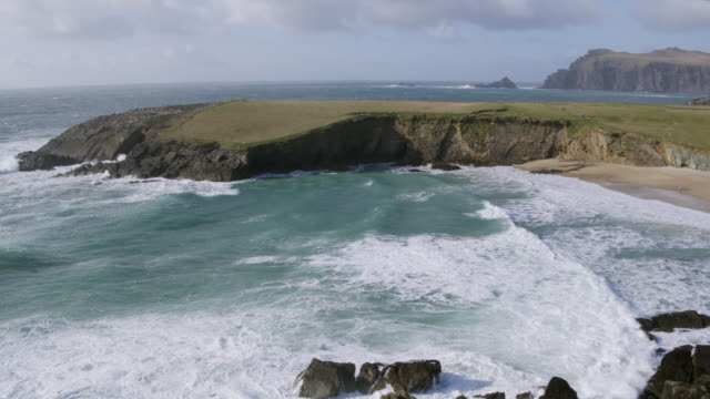 Aerial Footage Of Sea Waves And Mountain At Beach video