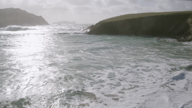 Aerial Footage Of Sea Waves And Mountain On Sunny Day video