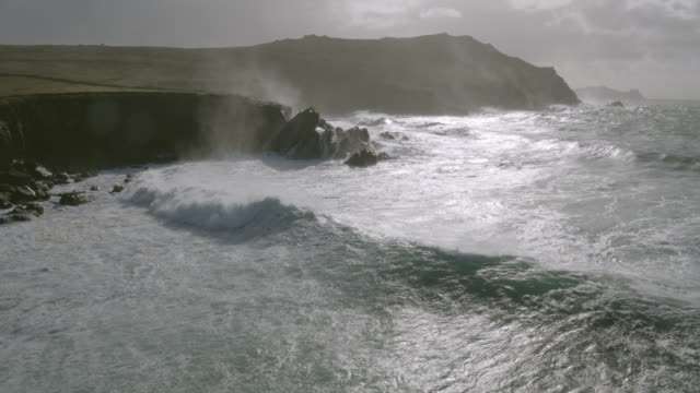 Aerial Footage Of Sea Waves Breaking On Rocky Mountain video