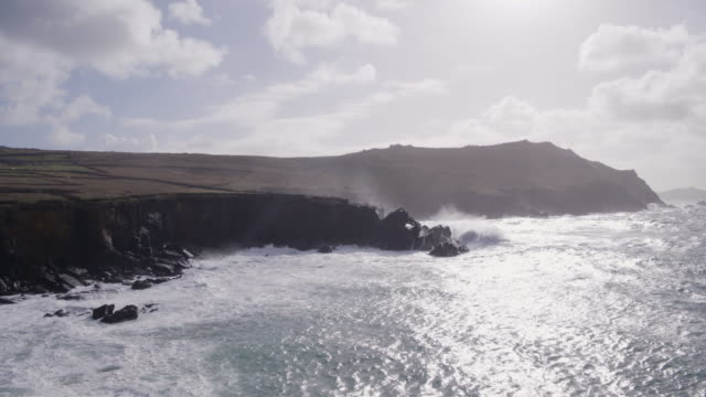 Aerial Footage Of Waves Crashing On Rocky Mountain Against Sky video