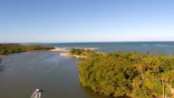 Aerial footage over a river and a small town on the brazilian coastline. video