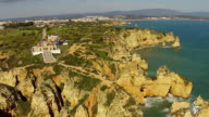 Aerial from Lighthouse and natural rocks at Lagos Portugal video