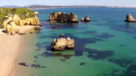 Aerial from natural rocks in Lagos Portugal video